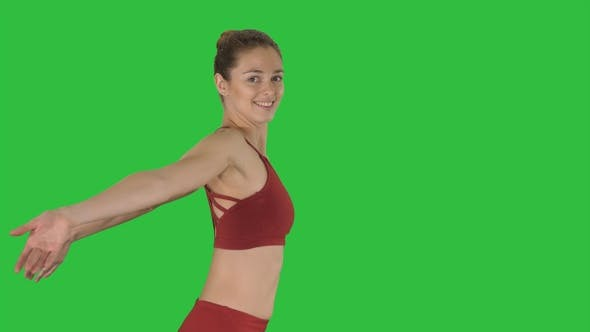 Thumbnail for Sportive fitness sportswoman stretching arms and laughing