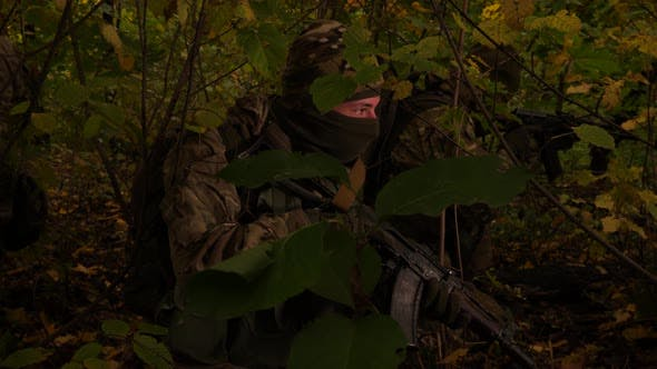 Thumbnail for Masked Commandos in the Forest. A Soldier with a Rifle Is Watching Closely. Special Forces Are