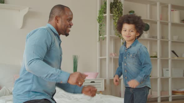 Cover Image for Joyful Black Father and Cute Son Dancing at Home