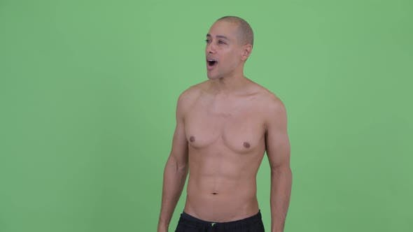 Happy Bald Multi Ethnic Shirtless Man Looking Around and Feeling Excited