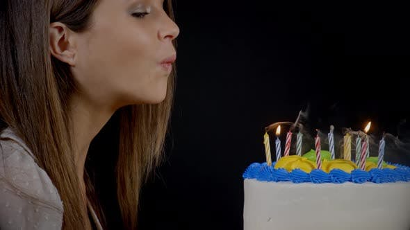 Thumbnail for Blowing Out Candles On A Birthday Cake