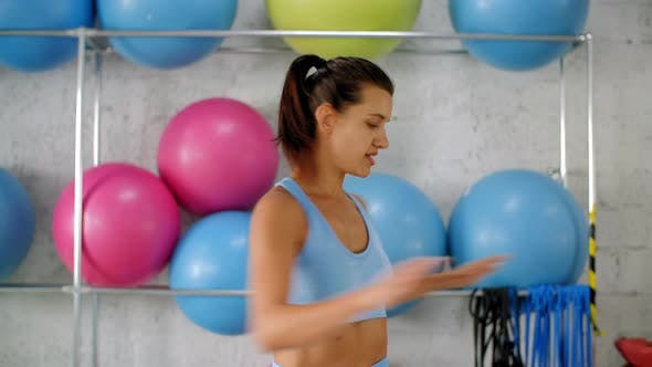 Thumbnail for Sporty Woman Twisting Torso and Training in Gym