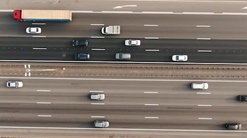 Automobiles and Lorries Drive Along Autobahn Lanes Aerial