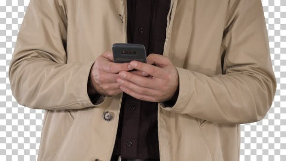 Thumbnail for Man in trench coat using mobile smart phone, Alpha Channel