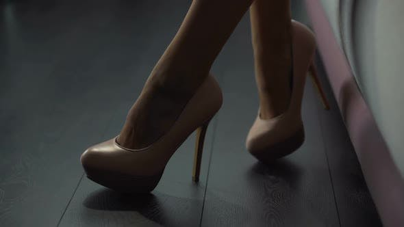 Cover Image for Close-Up of Gorgeous Female Feet in Stunning High Heels, Tender Leg Movements