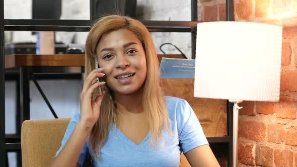 Thumbnail for Black Girl Talking On Smartphone