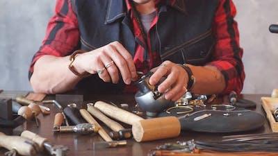 Craftsman Fixing a Jewel in Earring