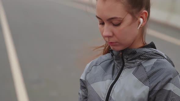 Thumbnail for Female Jogger Using Technologies