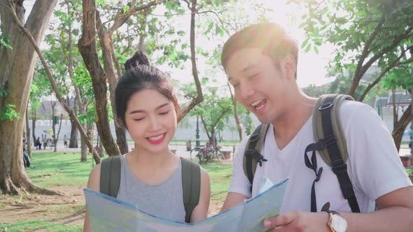 Traveler Asian couple direction on location map in Bangkok, Thailand.