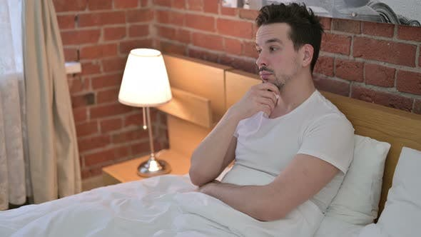 Thumbnail for Young Man Sitting and Thinking About Creative Idea in Bed