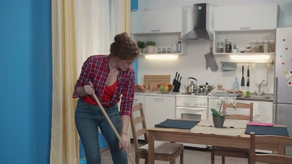 Woman Is Doing a Housework with a Mop