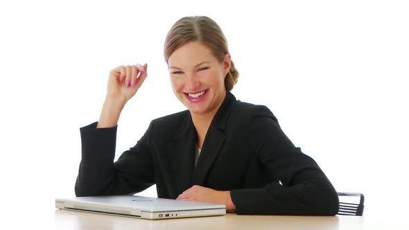 Thumbnail for Portrait of businesswoman leaning on desk