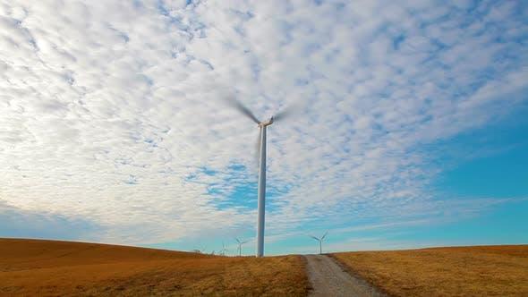 Thumbnail for Iowa Windmills near a dirt road