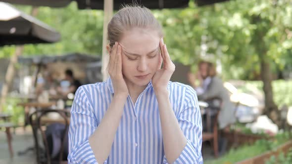Thumbnail for Young Woman with Headache Sitting in Cafe Terrace
