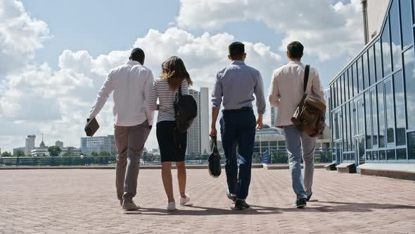Thumbnail for Rear View of Business Team Walking Outdoors