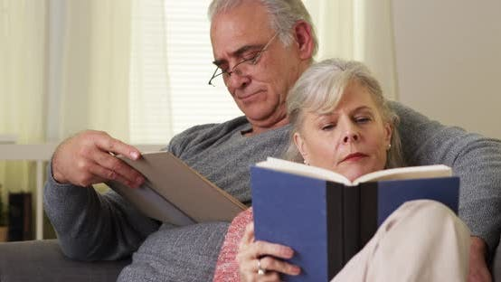 Thumbnail for Senior couple reading books