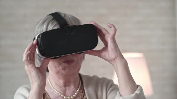 Cover Image for Old Woman in VR Headset Dancing with Excitement