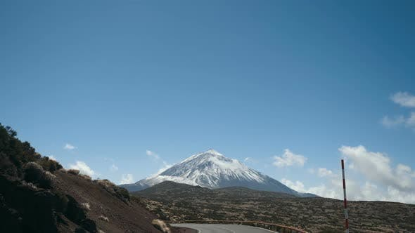 Driving a Car in Teide National Park, Tenerife, Canary Islands, Spain. Volcanic Rocky Desert