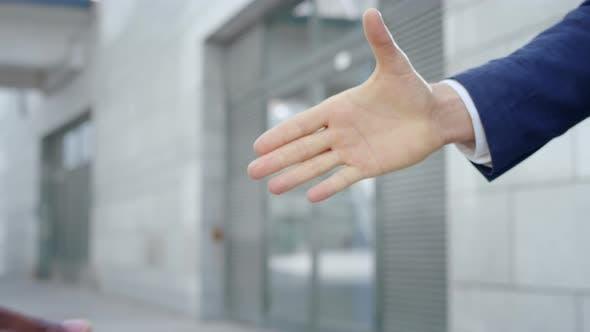Thumbnail for Business Partners Shaking Hands on Street. Handshake of Businessmen Outdoors
