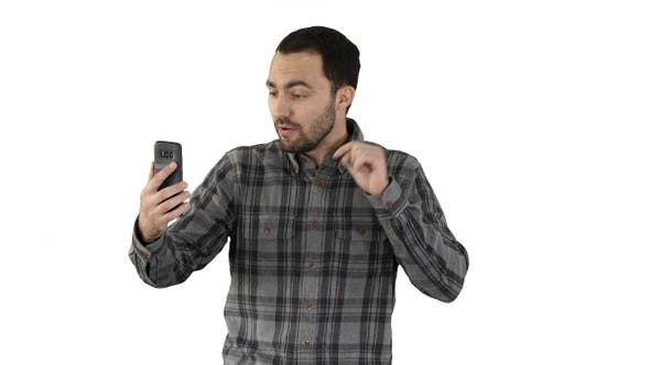 Thumbnail for Young blogger recording video on his phone while walking