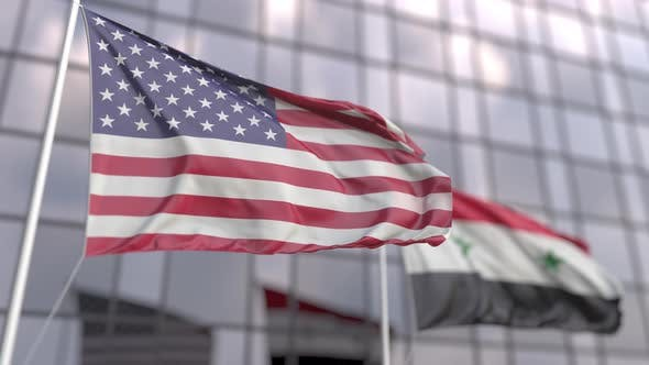 Waving Flags of the USA and Syria in Front of a Modern Skyscraper