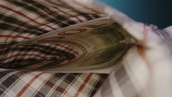Thumbnail for 100USD Bill Left in Shirt Pocket