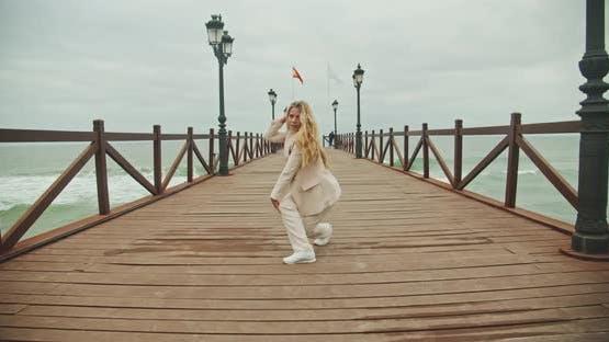 Dancer Performing Cartwheel On Seaside Pier