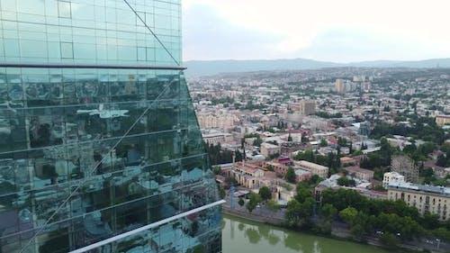 Glass Skyscraper And City View