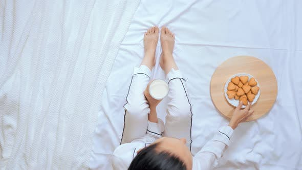 Thumbnail for Above View Caucasian Woman Has Dinner in Bed