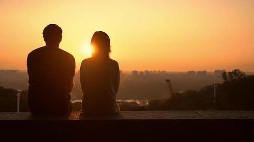 Couple Observing the Sundown