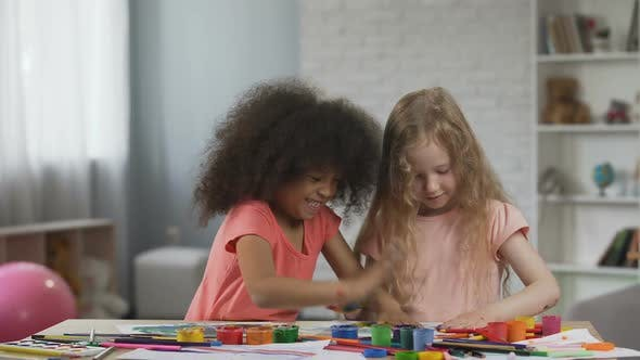 Thumbnail for Little Multiracial Friends Making Colorful Handprints on Papers, Having Fun
