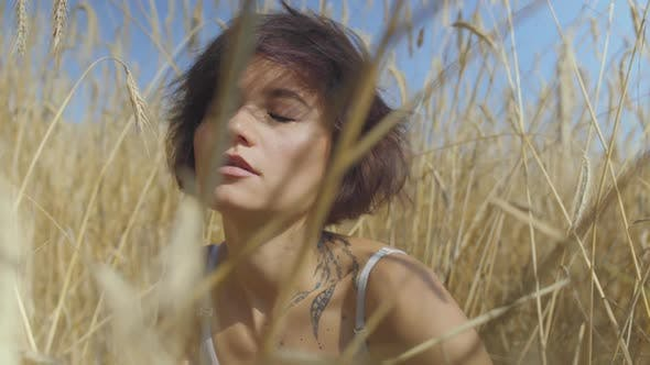 Thumbnail for Brunette Woman with Short Hair on the Wheat Field