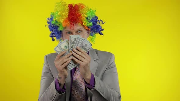 Thumbnail for Clown Businessman Entrepreneur Boss in Wig Shows Tricks with Money Banknotes