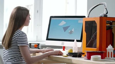 Woman Drawing 3D Model on Computer