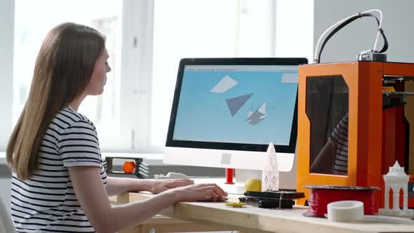 Thumbnail for Woman Drawing 3D Model on Computer