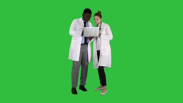 Cover Image for Medical staff working in front of a grey laptop while standing