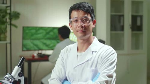 Portrait Of Biologist Man Analyzing Genetically Modified Organism For Microbiology Experiment