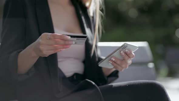 Thumbnail for Cropped Shot of Girl Holding Credit Card and Using Smartphone