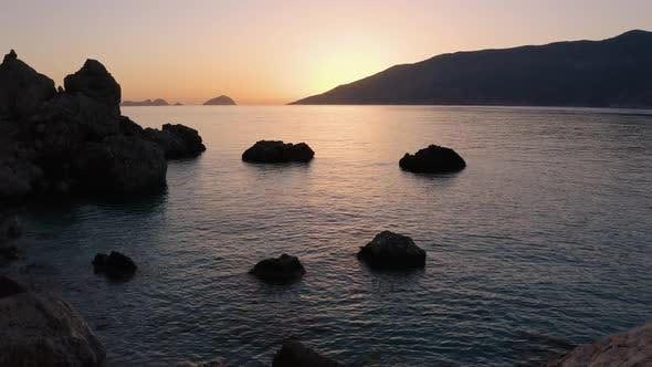 Rocky Tropical Coast at Sunset