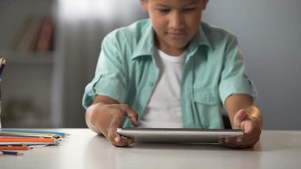 Cover Image for Male Kid Enthusiastically Playing on Tablet, Addiction to Gaming, Problem
