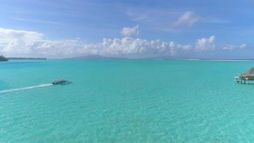 A boat in a tropical lagoon in Bora Bora tropical island