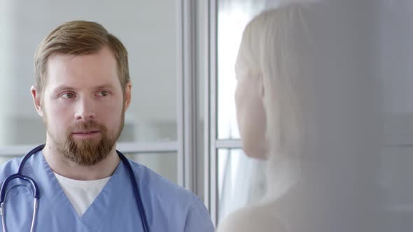 Thumbnail for Young Male Doctor Speaking with Female Patient