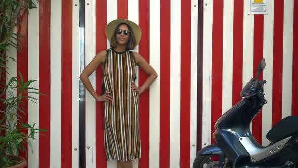 Thumbnail for A woman with stripes when traveling in a luxury resort town in Italy, Europe.