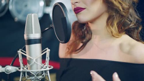 Professional musician recording new song or album in studio.