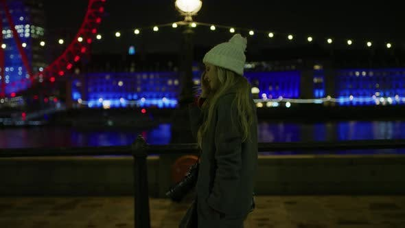 Thumbnail for Girl Walking and Admiring the London Eye, at Night
