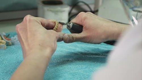 Dental Technician Making Deture Prothese