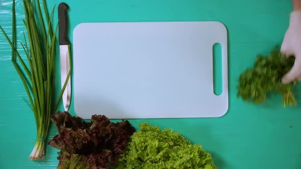 Thumbnail for Man Takes Away Green Plants From the Table