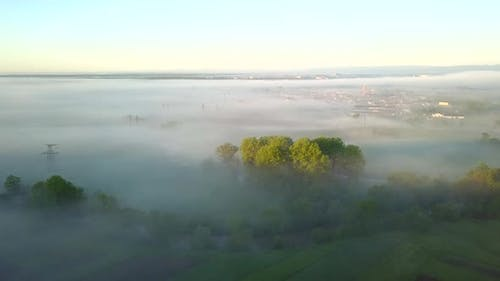 Aerial view of morning for over village houses on green spring hills.