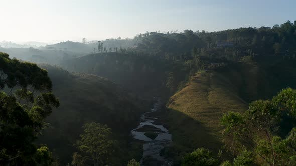 Cover Image for Aerial View of Tea Plantations, Fields, Waterfall During Sunrise. Sri Lanka Island
