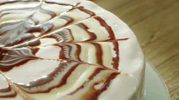 Thumbnail for Closeup Tasty Round Dessert Covering with Sugar and Chocolate Syrup.